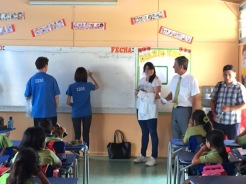 Demonstrating Chinese writting on the white board